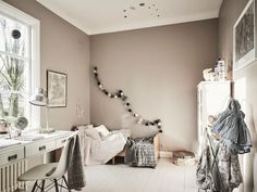 Little girl's bedroom in a romantic Swedish home with vintage touches