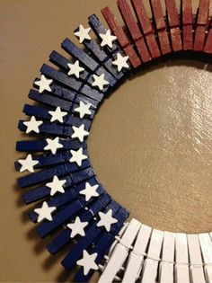 Fourth of July wreath. Clothes pins paint and stars. Use a wire hanger as the wreath. Easy on the wallet!