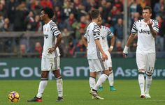 The Juventus FC players show their dejection during the Serie A match between Genoa CFC and Juventus FC at Stadio Luigi Ferraris on November 27, 2016 in Genoa, Italy.