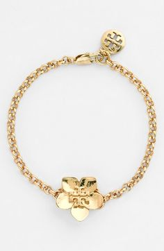 Free shipping and returns on Tory Burch 'Cecily' Logo Bracelet at Nordstrom.com. A signature Tory Burch logo centers a beautiful golden bloom on a simple bracelet perfect for wearing alone or layering with others.