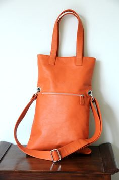 b1f58c23bf78 I want this bag! Light orange with the burgundy (pattern) liner! Orange