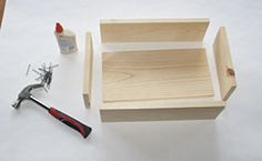 Step 5:  Next, using the cut boards from step 2 and the image as a guide, assemble the top of the step stool. Attach the pieces with wood glue and finishing nails.