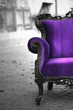 black and purple velour chair...there's something interesting about royal chairs in outdoor spaces