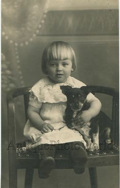 Little girl on chair hugging a cute puppy