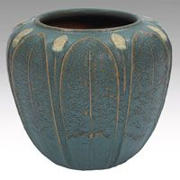 "Rare Grueby vase, nice broad form with carved and applied leaves and buds, covered in a very unusual light blue suspended matte glaze, marked, paper labels, 8""w x 6.5""h $4,000 - $5,000"