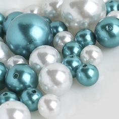 Wholesale Elegant Vase Fillers - Approx 42 Assorted Oversized Pearls in Turquoise and White Beads - Unique Decorative Gems Holiday Accents,http://www.amazon.com/dp/B00CXPIVJ2/ref=cm_sw_r_pi_dp_Kjkntb1BRK5W826G