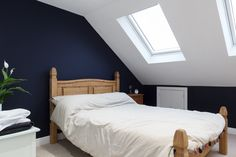 This loft bedroom conversion in North London features a double bedroom with a f. - Home - Eaves Bedroom, Bedroom Blinds, Bedroom Loft, Home Bedroom, Skylight Bedroom, Bedroom Ideas, Terraced House Loft Conversion, Loft Conversion Bedroom, Loft Conversion In Bungalow