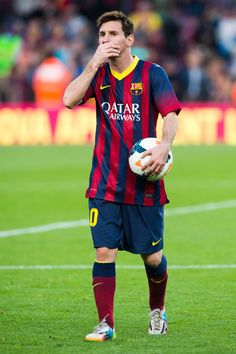 Lionel Messi with the ball after scoring a hat-trick during the La Liga match between FC Barcelona and CA Osasuna at Camp Nou on March 16, 2014 in Barcelona, Catalonia.