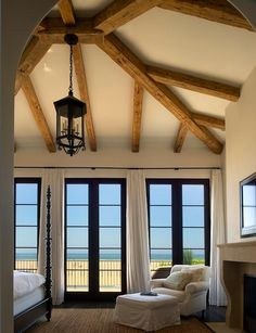 Don't know what to look at first....the architectural beams on the ceiling, that beautiful chandelier, or the incredible walk out view!