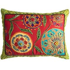 Buy or make solid pillow cover; stencil/trace pattern; embroider design.