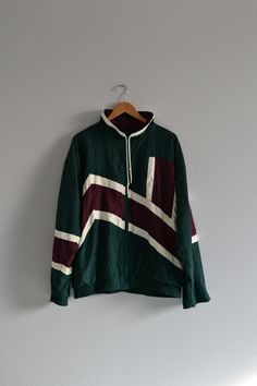 This is a great late 1980s early 1990s colorblock windbreaker in colorful blocks…