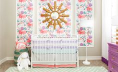 J & J Design Group shares a peek at their latest design. From the floral wallpaper to the oversized wall decal, you'll love this whimsical girl's nursery.