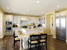 Eating from two sides, can still talk with each other.... Kitchen Islands: Beautiful, Functional Design Options | Kitchen Designs - Choose Kitchen Layouts & Remodeling Materials | HGTV