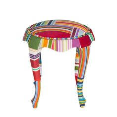 The Patchwork Jr. Stool  'The Patchwork Jr. Stool' is a hand stitched unique patchwork design with one of a kind fabric combination. Woven silks, velvets and printed satin  textures has been used harmoniously. High quality feather used for filling.  For additional sizes or colour  combinations please contact us.  info @ patchwork4home.com