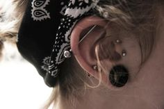 industrial piercing, cartilage piercings, tragus piercing and a plug