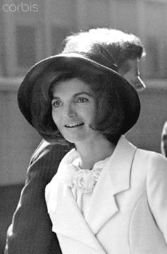 First Lady Mrs. John F. Kennedy at Union Station First Lady Jacqueline Bouvier Kennedy attends the departure of King Hussan of Morocco from Union Station. Her husband, President John F. Kennedy, is behind her. March 27, 1963.