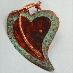 Hand Forged Rustic Copper Heart Pendant and Clasp by SunStones, $19.00  This heart shaped component is made from copper-designed two heart shapes, hand cut with a jeweler's saw, hammered, filed the edges, and oxidized. After those processes, I added a different patina to each piece. I formed 14 gauge wire and riveted it onto the two heart shapes - functioning as a bail which is also the part of the toggle clasp.