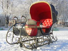 "Looks Like Christmas .""A Christmas Sleigh Ride In the Snow "" . an antique covered red and black sleigh. I'd love to take a ride in this sleigh."