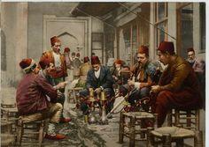 Turkish men in a cafe, smoking the Nargilah. Ottoman Empire 1880.
