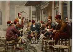Turkish men in a cafe, smoking the Nargilah. Ottoman Empire 1880.