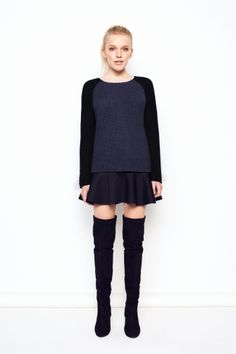 Chunky knitted sweater in navy blue with black sleeves.Loose fit.