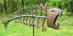 Found object welded garden art fish, Gone COASTAL. $425.00, via Etsy.