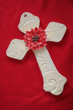 This cross was hand built from clay, as well as the flower embellishment. Clay Cross, Pottery Handbuilding, How To Make Clay, Crosses Decor, Hand Built Pottery, Pottery Classes, Clay Figures, Polymer Clay Creations, Ceramic Beads