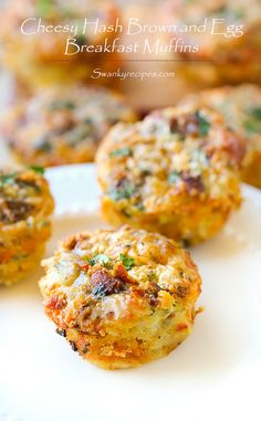 Cheesy hash brown, bacon and egg breakfast muffins. These muffin tin breakfast bites are stuffed with cheesy goodness: crispy bacon, hash browns, eggs, chopped vegetables, and herbs.