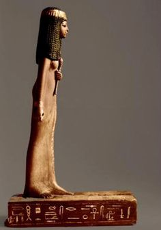 Wooden statuette ofLady Nay dedicated by her brother Ptahmay,New Kingdom, 18th Dynasty Ancient Egypt,c. 1400B.C.