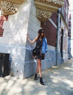 Andy Torres is wearing a dress from & Other Stories, boots from By Malene Birger, sunglasses from Miu Miu, denim jacket from ASOS and the bag is from Neri Karra #Handbags