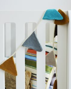 would be cute to make bunting from upcycled sweaters...