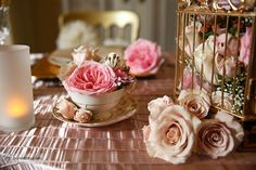 Pink roses and baby's breath in teacups added that necessary touch of vintage along with a gold birdcage filled with flowers. (Flowers designed by Janelle Gerestein of Creative Weddings Floral Designs)