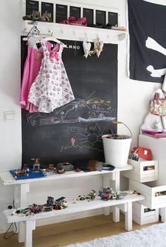 Blackboards, shelves and hooks.