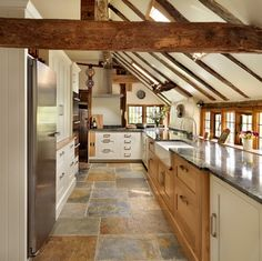 Love this ... the cute little low windows, the wood beams, and the floor that pulls all the colors together ... awesome