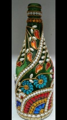 These vodka bottle crafts offer a tons of tips to reuse and reinvented this daily merchandise. Bead Bottle, Glass Bottle Crafts, Wine Bottle Art, Plastic Bottle Crafts, Diy Bottle, Vodka Bottle, Mosaic Bottles, Painted Glass Bottles, Decorated Wine Bottles