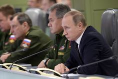 Russian President Vladimir Putin, right, and Defense Minister Sergei Shoigu