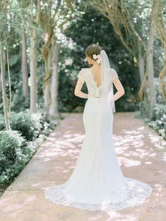"<div>The two-piece element of this dress is so subtle that on first glance you might miss it, but a hint of skin keeps it sultry and unique.</div><div><br></div><div>More Dress Inspiration Inside <a href=""http://www.stylemepretty.com/vault/search/images/Wedding%20Dresses"">THE VAULT</a></div>"