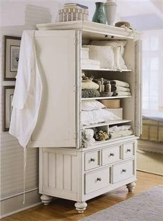Great old armoire turned into a linen closet.  Also a good idea to repurpose those old TV armoires that are no longer being used!  This would look great in my master bath.