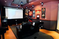 I have always been a fan of the projector and screen setup... If you can pick the right one, your picture can be bigger, as good if not better, and possibly even cheaper then your flat screen TVs.. another must have.. (living/intertainment room ideas)