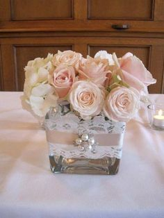 20 Inspiring Vintage Wedding Centerpieces Ideas square vase wedding centerpiece with pearls. Square Vase Centerpieces, Communion Centerpieces, Pearl Centerpiece, Vintage Wedding Centerpieces, Wedding Table Numbers, Wedding Decorations, Girl Baptism Centerpieces, Shower Centerpieces, Balloon Decorations