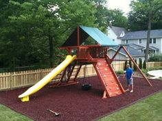 Wood lined mulch bed for swing set area