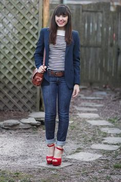 Fashion Click blogger Veronika Placek of Tick Tock Vintage looks collegiate-chic in a navy blue blazer and nautical striped tee. She punches up her prepster-approved outfit with bright red platform heels.
