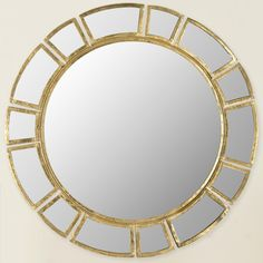 Features:  -Construction Material: Iron frame with a manufactured wood backing and mirrored glass.  Shape: -Round.  Style (Old): -Contemporary.  Mirror Type: -Accent.  Orientation: -Both.  Framed: -Ye