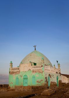 green paint peeling on a beautiful mosque...