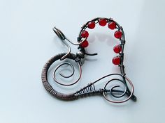 US price, $13.26 Copper wire wrapped heart pendant with red jade beads. zł40.00, via Etsy.