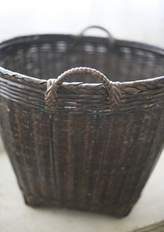 dark woven laundry basket.