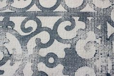 Use a rubber door mat to make a design on a rug