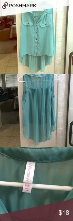 Flowy Blouse Tank Flowy sea foam green blouse tank. Longer in back with nice detail. Breast pockets. Buttons all the way down. Collar. Sheer so camisole to be worn under. Lovely too. Can be dressed up or down. Worn once. Perfect condition. Open to offers Xhilaration Tops Tank Tops