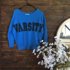VARSITY sweater To me, this sweater resembles PINK. Though it's not.. I still think it is super cute. It can also be worn off the shoulder. Tops Sweatshirts & Hoodies