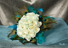 Peacock Bridal Bouquet for a lovely and a bit different look. #Weddings #WeddingFlowers